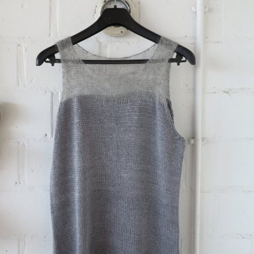 Hand knit top by Wollmuschi in gray colors.