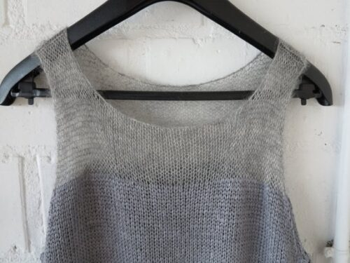 Hand knit top by Wollmuschi in gray colors. Detail view.