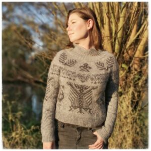 PDF knitting pattern SIGNUM woman underneath tree wearing hand knit sweater called Signum