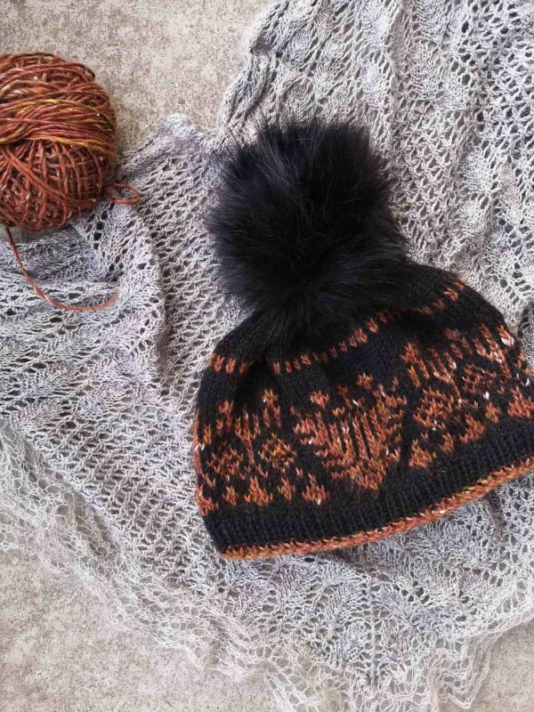 Hand knitted EMI hat lying on the floor