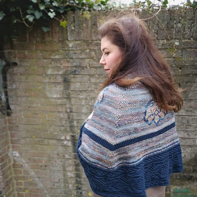 Hand knitted stole called blauw bloed worn by woman