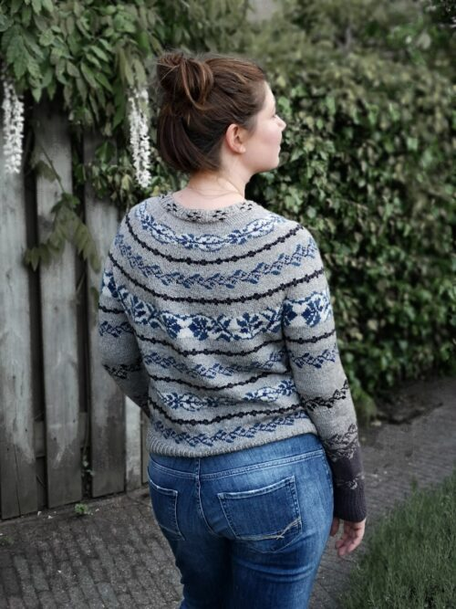 moan sweater shown from behind