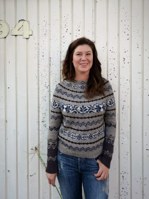woman wearing moan sweater in front of white background